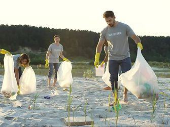 Volunteers gathering plastic waste